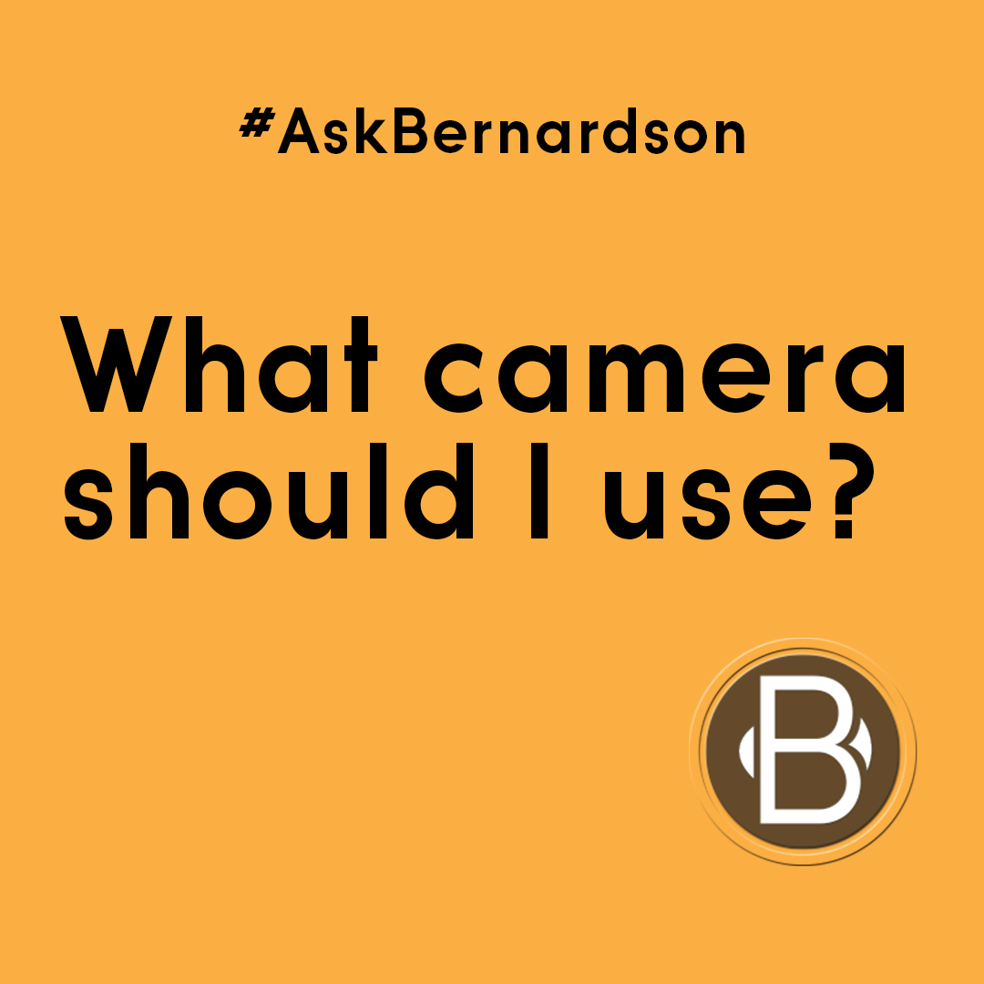 "the text in black and orange background says: ""#AskBernardson What camera should I use?"""