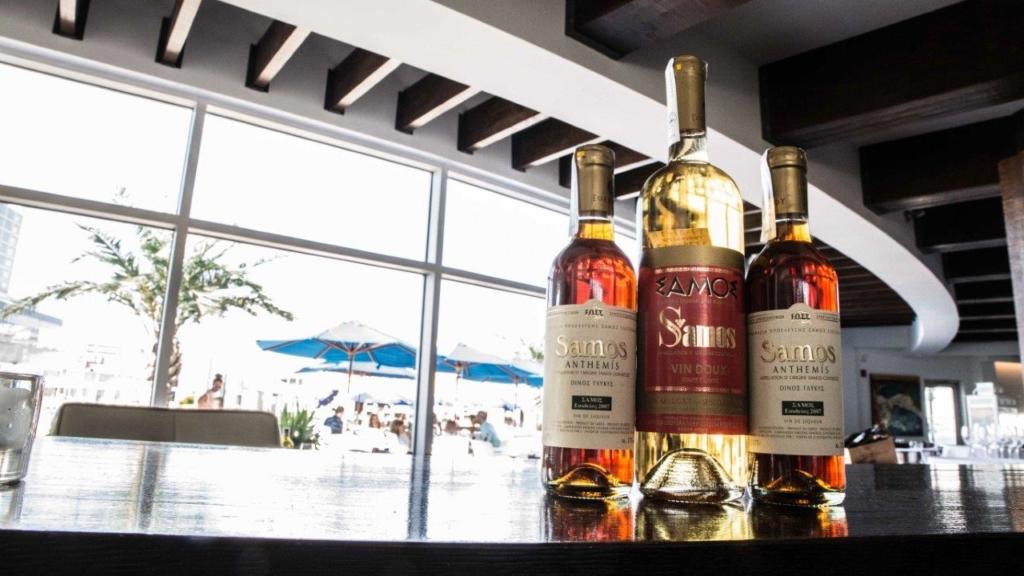 three bottle of samos wine on a bar at Skara cuisine mediterraneenne