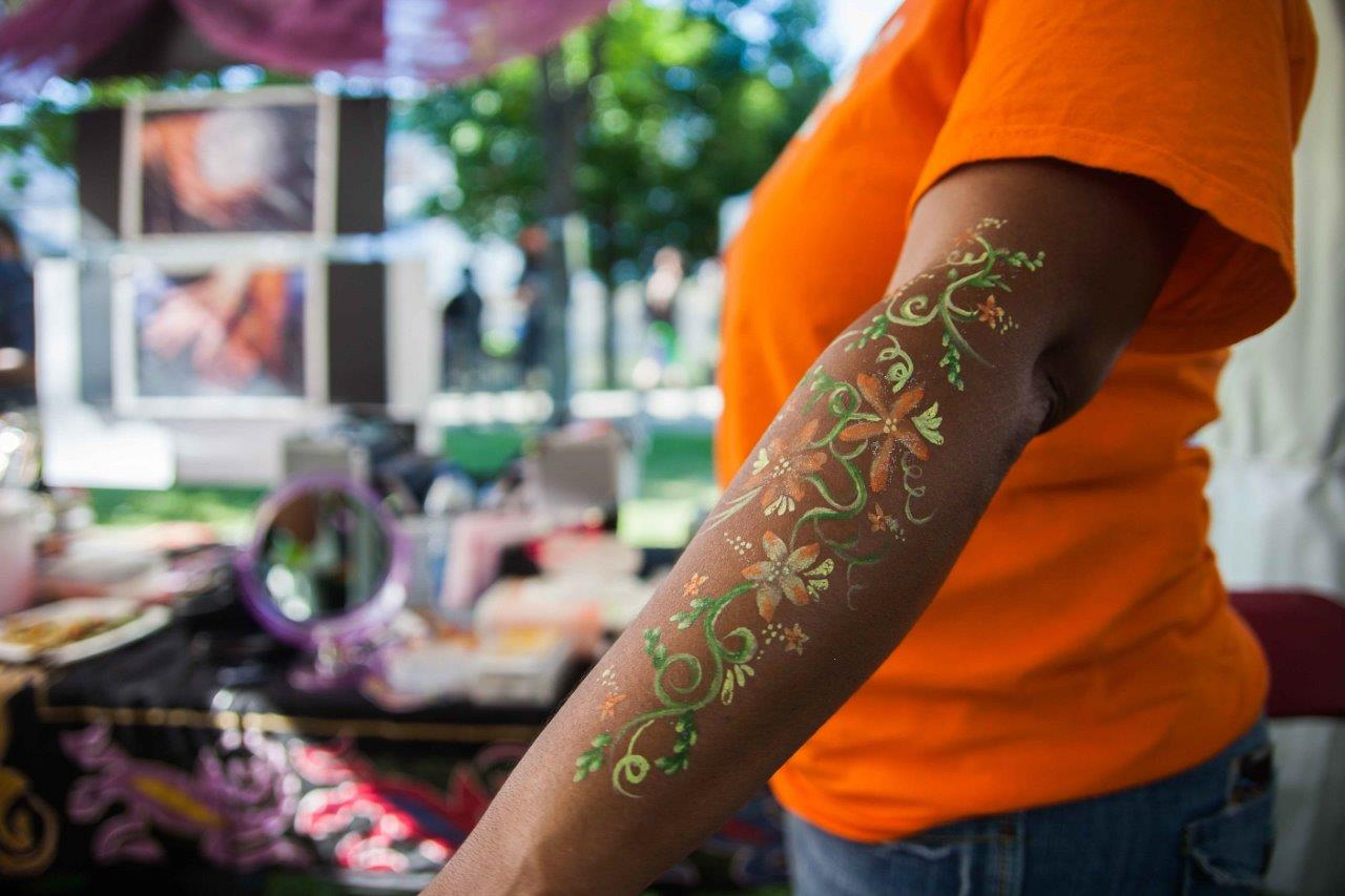 A harm with body painting for a cultural festival