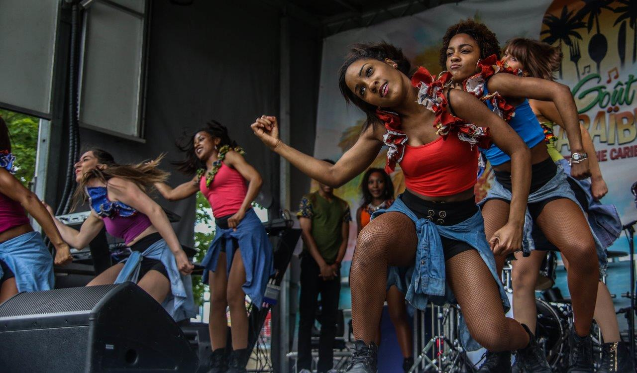 A motion dance crew dancing afrobeat on stage