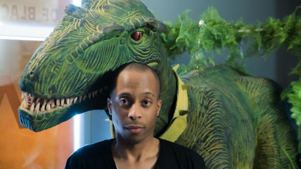 Bernardson standing in front of a dinosaur of Escaparium Montreal