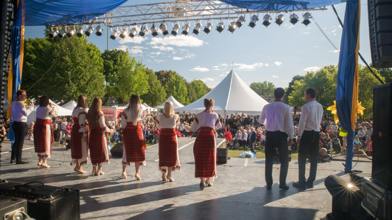 A group of people standing in front of a crowd at the Montreal Ukrainian festival