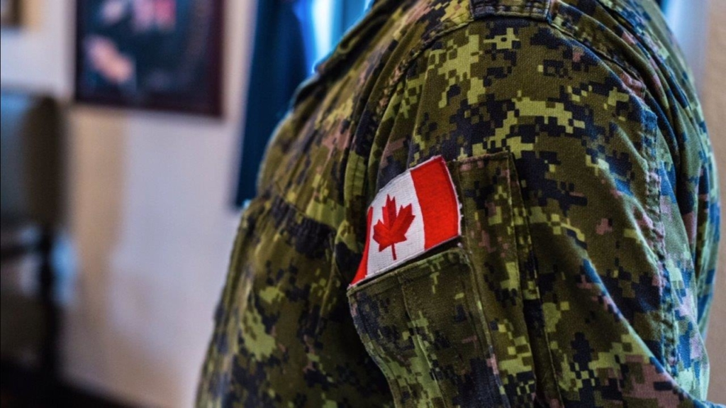 A close up of a canadian flag on a military uniform